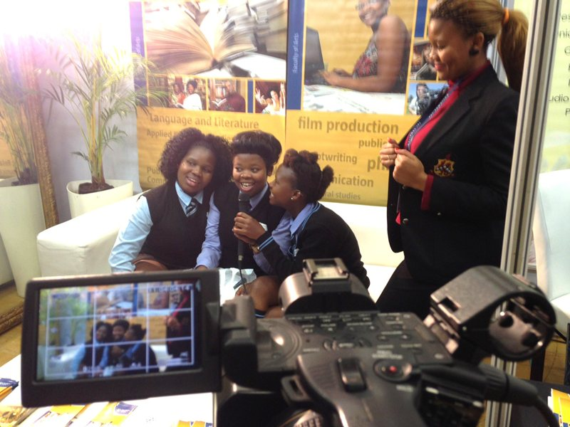 Potential students practicing video broadcast skills at NMMU Open Day 2014.